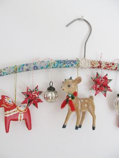 hang ornaments from a fabric covered hanger. simple and cute