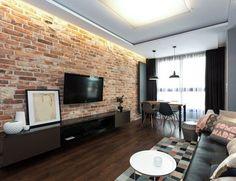 Wohnzimmer im Industrial Style - rote Ziegelwand und schwarze Möbel