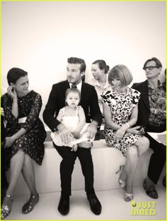 The 39-year-old designer's hubby David sat in the front row next to Anna Wintour with their precious daughter Harper, 2, on his lap.