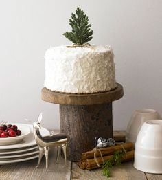 Adorable - a cake stand made from a tree trunk! More DIY nature-inspired holiday ideas: http://www.bhg.com/decorating/do-it-yourself/accents/nature-crafts-for-winter-table/
