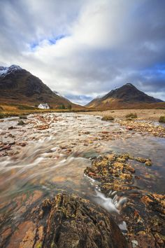 Lagangarbh Cottage at the eastern end of the Pass of Glen Coe, Scotland.   Captured from a low vantage point with the River Coupall in the foreground.