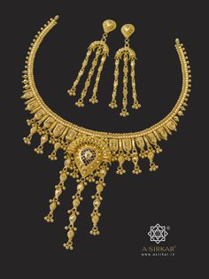 Tilak Necklace :  Even the smallest of jewels can be a treasured possession and this attractive little set shows you why. Intricately combining ball, katai, reji, rope and mesh-work, the Tilak necklace is sweetness personified.  Hand-crafted to perfection in 22k gold.  Comes with matched cascade earrings.