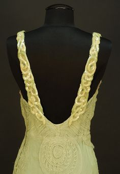 "Strap Detail WORTH NET EVENING GOWN with SEASHELL DESIGN, c. 1932. Sleeveless pale seafoam green V-neck decorated with large shells of various types, the straps with iridescent sequin decoration and scattered rhinestones at shoulder and down low back, attached seafoam crepe de chine slip, side closure. Label ""Worth"". Belonged to Elizabeth Arden,"