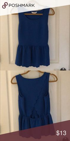 Royal blue peplum top Really cute peplum top with adorable open back Size small but could fit a medium easily too! Charming Charlie Tops Tank Tops