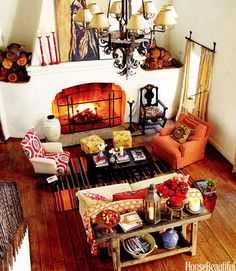 """This Ojai, California, living room is awash with bright orange and bold patterns. """"Don't go for matchy-matchy-matchy,"""" designer Kathryn M. Ireland says. """"I say, if it doesn't go, it goes.""""   - HouseBeautiful.com"""