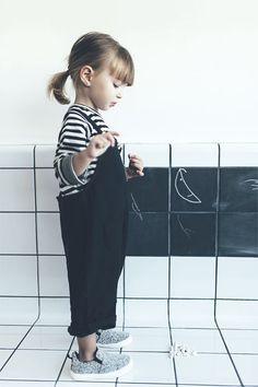 super cute little girls style | black overalls with striped tshirt and sneakers | kids style