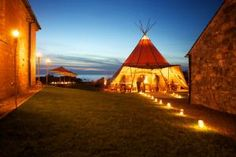 The teepee-style tents can hold as many as 400 people.