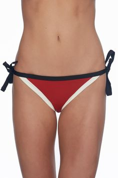 """Ellie bottom is a classic low-rise tie-sash bikini bottom. With medium coverage at the back this bottom looks great on and can be paired nicely with a variety of tops from this years Skye collection. SizeWaist Hips S27""""36-37"""" M29""""38-39"""" L31""""40-41"""" XL33""""42-43"""" Ellie Tie Side by Skye Swimwear. Clothing - Swimwear - Bottoms British Columbia Canada"""