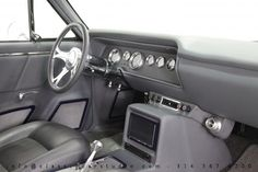 65 chevelle #BecauseSS blue with grey interior. custom door panels console double din tv.