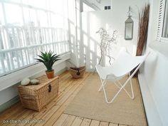 Little balcony with white Bat chair / Pieni valoisa parveke & Lepakkotuoli
