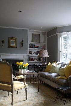 San Francisco interior designer Josephine Fisher used a combination of  of gray with yellow and chartreuse  accents in this livingroom. Phot...