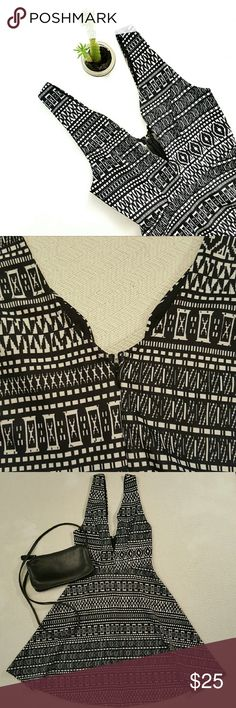 Size M Seductions B&W Tribal Print Dress This listing is for a Seductions B&W tribal print dress. It features a V cut in the front and has a metal piece inside the dress to keep in place. This dress is preloved but is in excellent condition no flaws were found.  Condition is 9/10.  #003 Seductions Dresses Midi