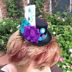 Mad Hatter Top Hat with Peacock, card, key, antique buttons, and Satin Flowers #madhatter #alice #wonderland #aliceinwonderland #tophat #hat #lewis #carroll #disney #theme #birthday #unbirthday #shower #bridal #baby