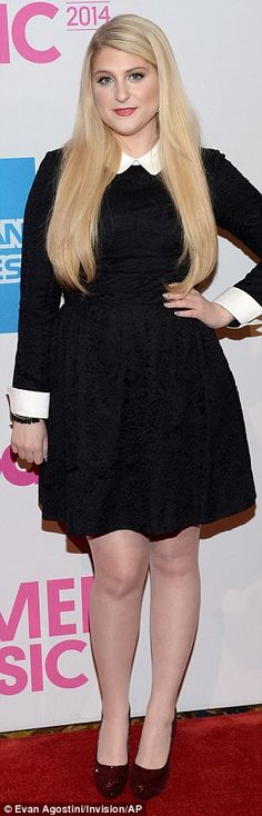 All buttoned-up: Idina Menzel and Meghan Trainor were prim in high-collared black dresses at the event