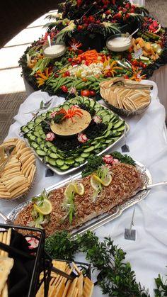 Hummus, cucumber, pita, and veggie display