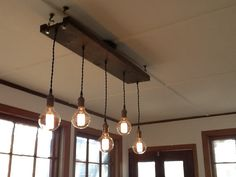 All Chandeliers are custom and handmade to order any way you like. Just leave a note during checkout to specify your custom options! See listing photos for all available choices. Includes 5 Pendants in any custom colors and choice of wood base. Default as pictured 36 x 8 reclaimed