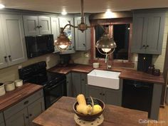 gray cabinets Love the coziness of this rustic kitchen! Cabinets are our Deerfield Shaker II Maple Creek Stone paired with wood countertops. Rustic Kitchen Cabinets, Refacing Kitchen Cabinets, Kitchen Cabinet Doors, Kitchen Redo, Kitchen Remodel, Kitchen Ideas, Gray Cabinets, Kitchen With Wood Countertops, Kitchen Pics