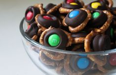 Pretzel&m&ms. Use a hersheys kiss in the center and bake for 3 minutes then top with the m&m. YES!!!