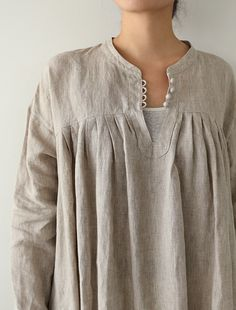 I love the button detail here: a fall into winter smock like layer [Envelope Online Shop] Cleo Lisette dress