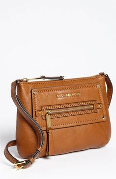 Gorgeous mauve handbag purchased early in the fall. Excellent condition! Very clean interior. Hardware is a beautiful gold. A combination of mauve and brown in color.