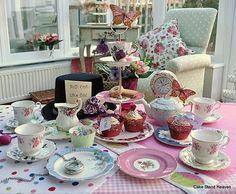 A Vintage Tea Set for a Little Alice in Wonderland  http://vintagecakestands.blogspot.com/2011/01/vintage-tea-set-for-little-alice-in.html