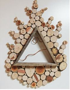 No - no trees were harmed in the making of these beautiful works of art. :) Instead, Oregon based Wild Slice Designs searches for dead and discarded tree limbs to create these wall sculptures. Wooden Projects, Woodworking Projects Diy, Wood Crafts, Wall Sculptures, Wood Sculpture, Wood Wreath, Triangle Shelf, Wood Slices, Recycled Wood
