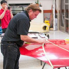 "The Family Handyman learns how to use automotive tape from Chip Foose, host of Velocity TV's ""Overhaulin. Truck Repair, Auto Body Repair, Big Dog Motorcycle, Auto Body Work, Car Painting, Airbrush Painting, Spray Painting, Chip Foose, Car Shop"