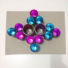Candle holder and shotglasses in metallic colors