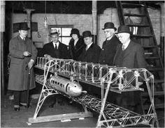 George Bennie (left) describes a model of the Railplane to potential overseas investors
