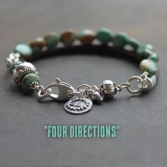 Four Directions captures the rugged spirit and colors of the desert. Green blue natural turquoise oval beads paired with genuine leather cord make this bracelet uniquely different. Equally lovely alone or in a stack, this bracelet features sterling silver beads and findings that shine against the earthy blues and browns. This artisan bracelet closes with a large sterling silver clasp. A studio made Hopi Sun charm hangs to one side. 6.85 inches. Need a different size? Ask me.