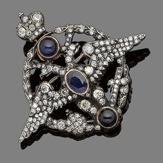 A sapphire and diamond brooch, circa 1890 Designed as a two-headed eagle within a circular openwork plaque, set throughout with old brilliant and single-cut diamonds, accented with circular cabochon and oval mixed-cut sapphires, to a similarly-cut diamond crown surmount, diamonds approx. 1.40ct total, Russian assay mark, width 5.2cm