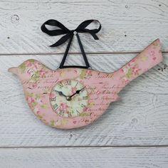 Pink floral bird clock on ribbon.