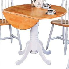 Round Dining Table with Drop Leafs - Coaster 4241 by Coaster Home Furnishings. $204.26. Single pedestal base. Turned legs. Made from solid wood. Round shape. Smooth rounded edges. The Round Dining Table with Drop Leafs from Coaster is great for those dining rooms with little room. The table has a white base while the top has a natural finish. It is usually in stock and ships to you at no additional charge.Dimensions:Table (Coaster Model 4241) 40 Diameter x 40 H. Save 34% Off!