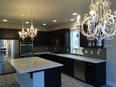 The Glamorous remodel: Statuario Polished quartz by Pentel, 3x12 glass tile backsplash, Kitchen Aid cooktop & refrigerator