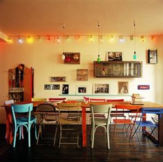 i like the eclectic collection of chairs and xmas lights