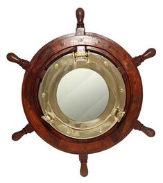 "Create an impressive focal point inside your home with the 17"" Porthole Mirror in 30"" Ship Wheel. Available at Everything Nautical, a family business since 1998."