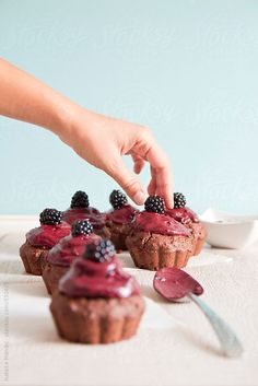 Chocolate muffins with blackberry frosting