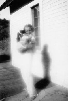 Norma Jeane with her dog Tippy, 1933.