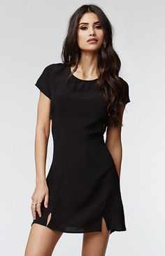 """A PacSun.com Online Exclusive!The Fit & Flare Cutout Dress by Kendall & Kylie for PacSun.com features side cutouts and short sleeves. We can't forget to mention the chic open back detail. Wear this stylish dress with your heels or sandals!   Unlined 34"""" length 6"""" sleeve length Measured from a size small Model is wearing a small Her measurements: Height: 5'7"""" Bust: 32"""" Waist: 24"""" Hips: 34"""" 100% viscose Machine washable Imported"""