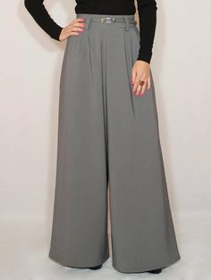 4412cc6272 Wide leg pants with pockets in Gray color. They designed with wide leg cut