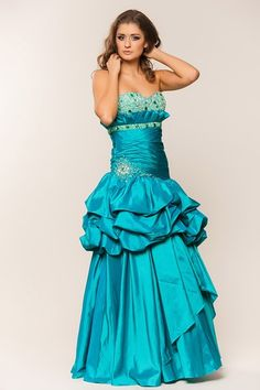 Beaded Prom Dress AA9537.  Full Length Prom Gown with Sweetheart and Strapless Beading and Gemstone Embellished Bodice with Side Zipper Closure, Open Back and Skirt Overlay Detail. https://www.smcfashion.com/wholesale-prom-dresses/prom-dress-aa9537
