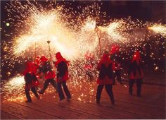 http://www.cometobarcelona.com/blog/ENG/image.axd?picture=2012%2F8%2FCorrefoc+Fire-Run%2C+Barcelona.jpg