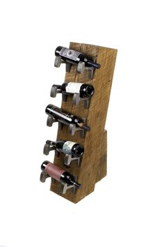 5 Bottle Rail Yard Wine Rack - his one uses 10 pieces of CARNEGIE 1899 rail. We took a mainline white oak timber and raked it back at a slight angle to add a sense of movement. A signature dome head drives spike holds the structure together.       reclaimed wood wine rack
