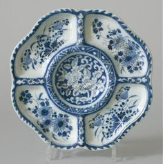 A Dutch Delftware blue and white chinoiserie compartmented dish