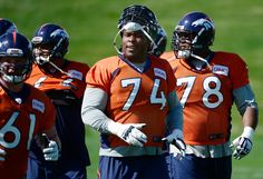 Description of . ENGLEWOOD, CO - SEPTEMBER 5: Orlando Franklin (74) and members of the offense take the practice field after finishing warm-ups. The Denver Broncos Football team practices at Dove Valley in Englewood in preparation for Sunday's season opener against the Indianapolis Colts. (Kathryn Scott Osler/The Denver Post)-- #ProFootballDenverBroncos