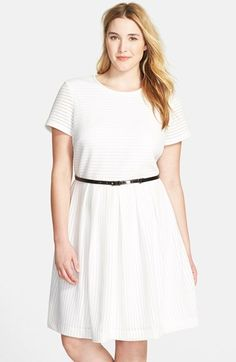 Free shipping and returns on Calvin Klein Textured Fit & Flare Dress (Plus Size) at Nordstrom.com. A fresh white dress cut with short sleeves features a textured fabric striped with rows of delicate pointelle stitches. A contrasting belt with gleaming hardware accentuates the waist-slimming silhouette.