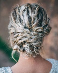 Beautiful messy braid updo wedding hairstyle for romantic brides - Bridal hairstyles. Get inspired by this braid updo bridal hairstyle,bohemian hairstyles
