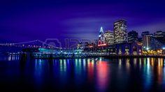 Ferry Building and Bay Bridge illuminated at night in San Francisco California USA