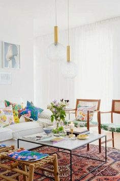 Eclectic mix of prints & patterns but room still has a light and airy feel