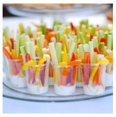 Veggie Cups - add dollops of dip to the bottoms of small, clear glass cups or votive candleholders, fill them with veggies and place on a tray of ice.